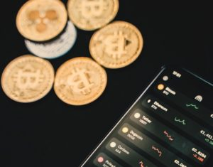 gold coin points aside with smartphone