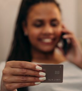 picture of woman using a credit card with a smile on his face